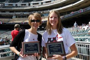 Kathy Hammill and Brooke Parvi received plaques from PeaceMaker Minnesota on behalf of LME.
