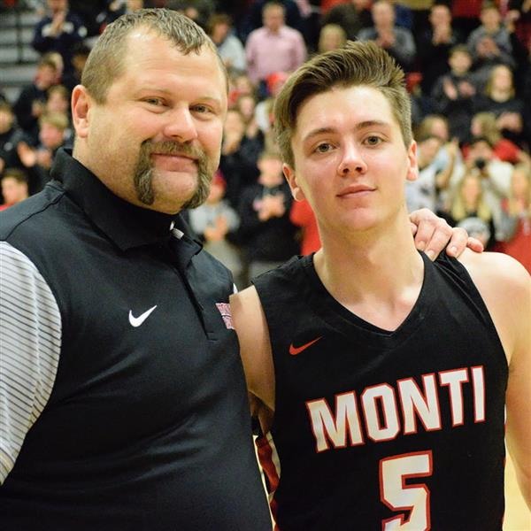 Matt Todd stands with Coach Jason Schmidt after Todd eclipsed Nate Holmstadt's 2,106 career points