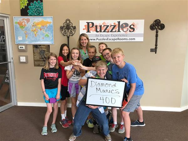 Students celebrate after completing an escape room during summer programming last year.